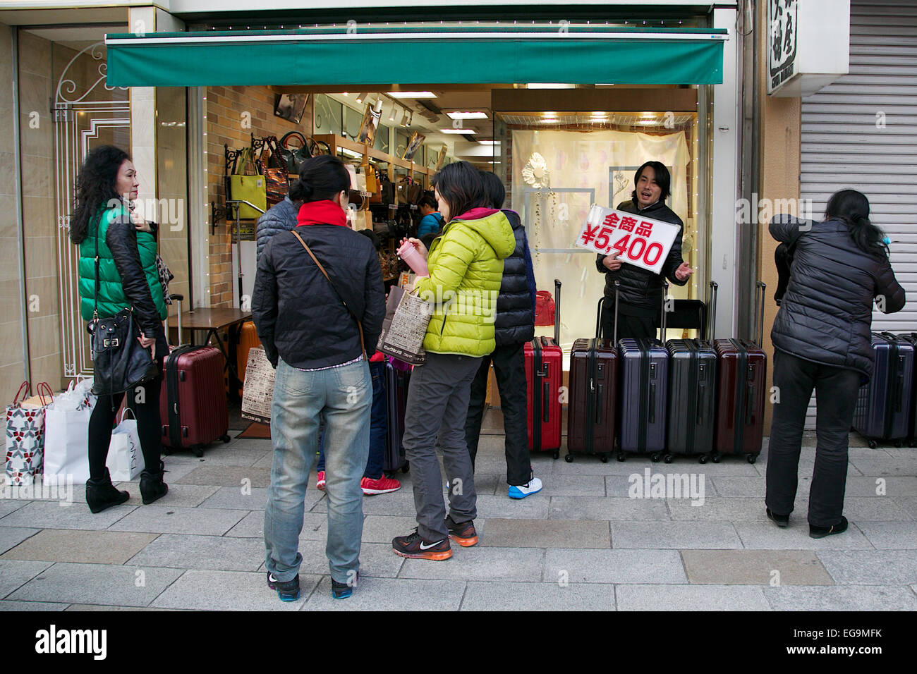 Asian tourists shopping during the Lunar New Year Holiday on February 20, 2015 in Tokyo, Japan. Asian shoppers buy Stock Photo