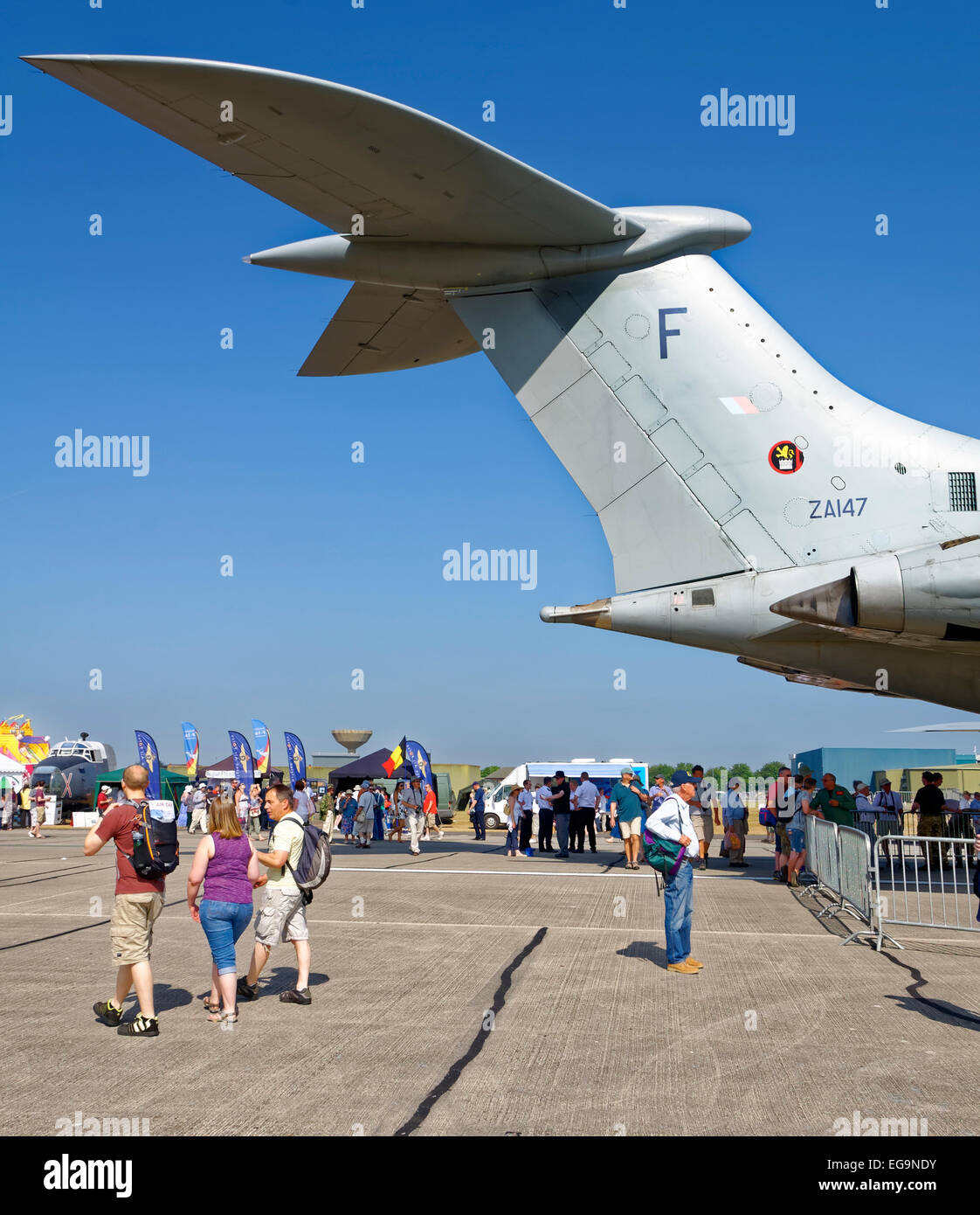 The tail assembly of a Vickers VC10 towers above air show spectators. - Stock Image