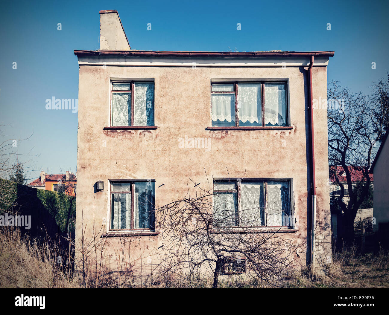 Retro vintage filtered old neglected house exterior. - Stock Image