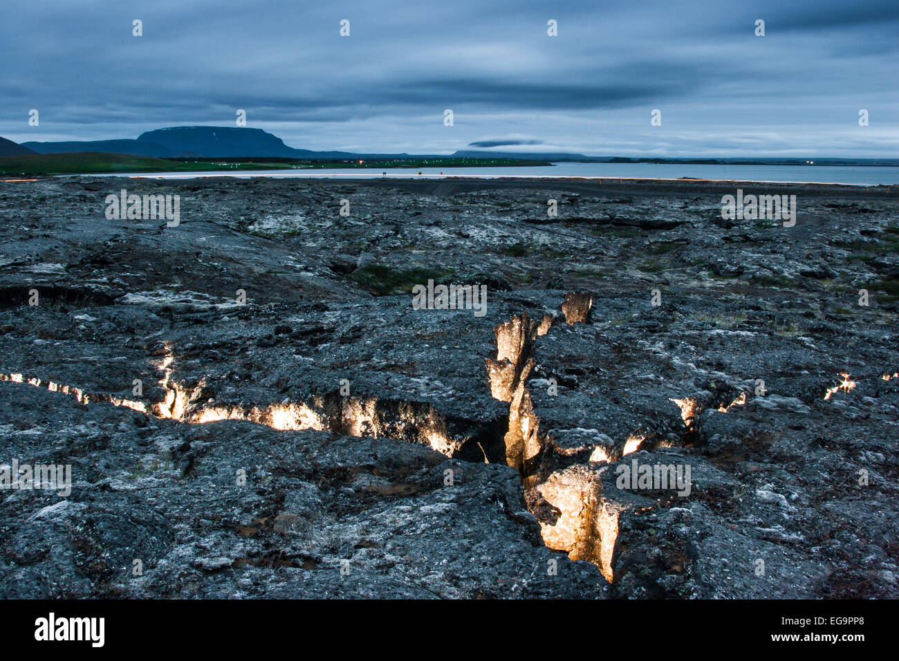 Diverging plates in a volcanic fissure zone, Myvatn, Iceland The fissures were lighted with a strobe light , Myvatn - Stock Image