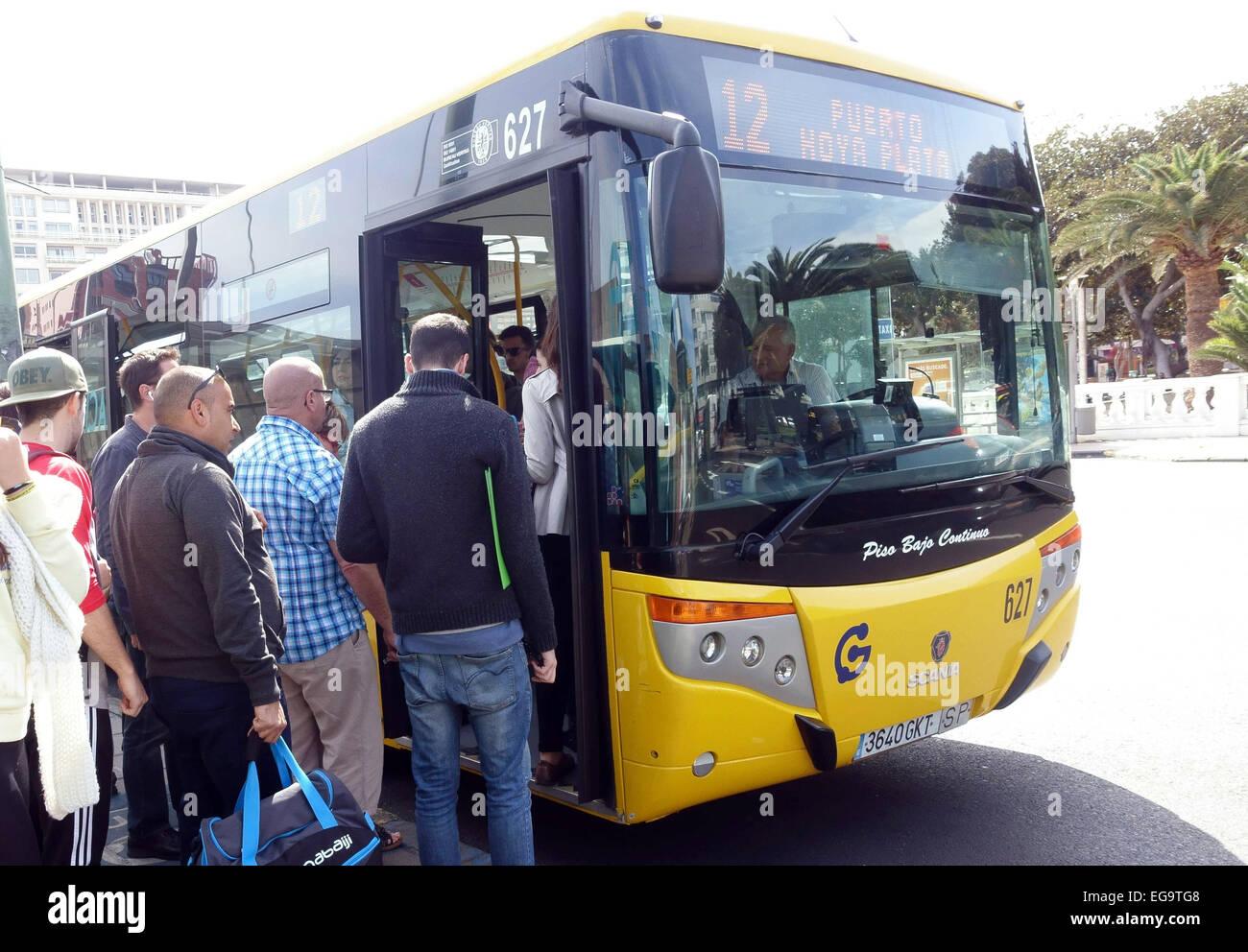 "passengers board bus or ""guagua"" in las palmas de gran canaria stock"