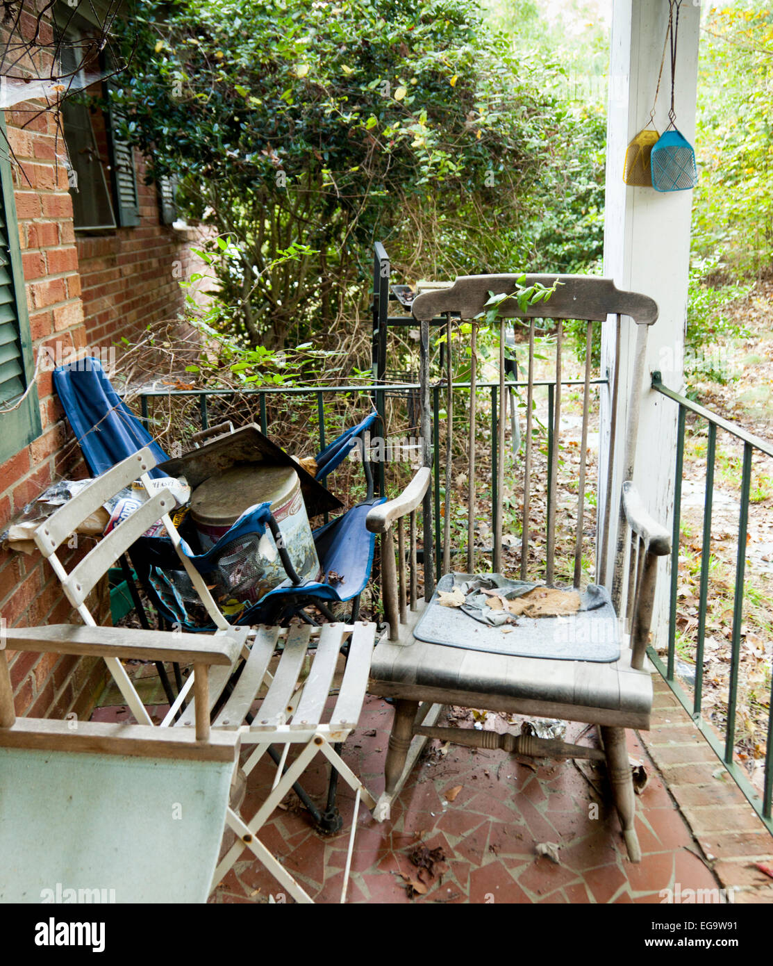 Rocking Chair And Other Chairs On A Porch In The Backwoods Of South Carolina