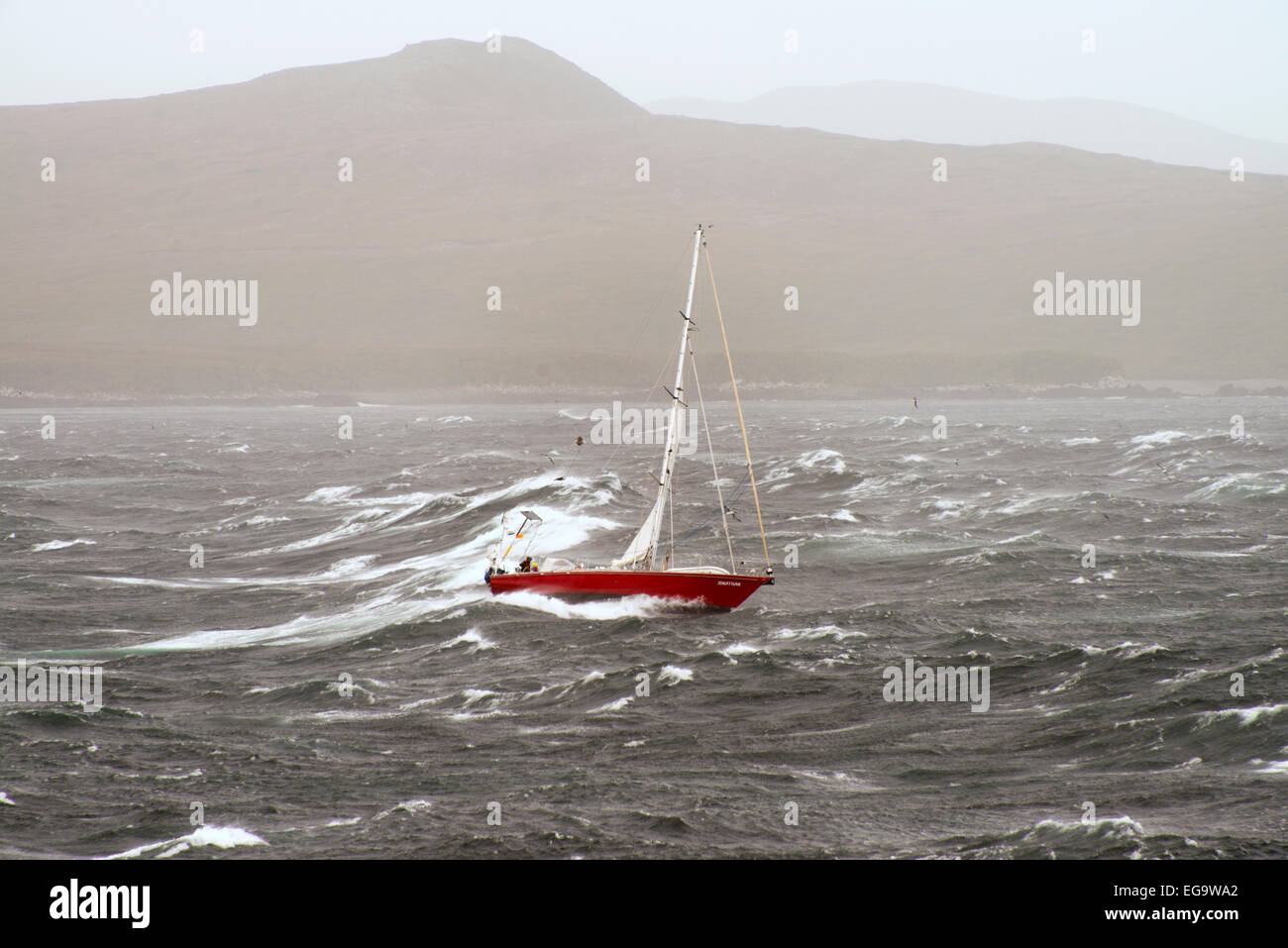 Yacht Jonathan rounding Cape Horn Tierra del Fuego Chile in a force 8 gale - Stock Image