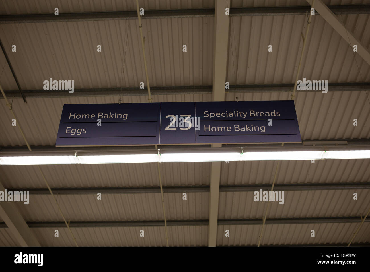 Tesco ailse no 23 sign, baking bread eggs - Stock Image