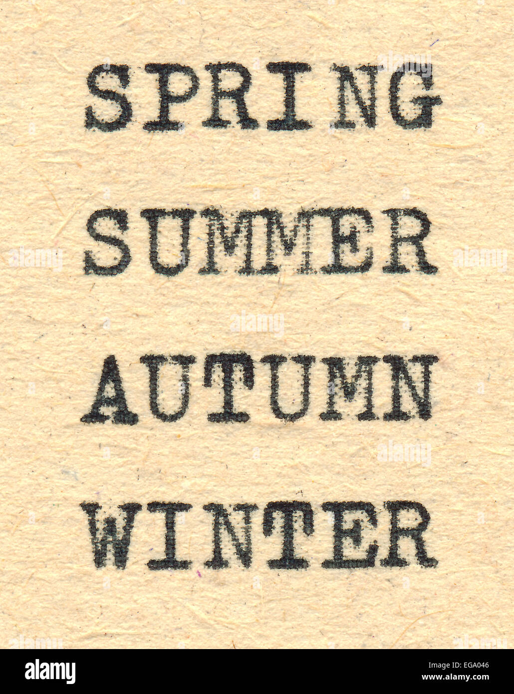 Season's names are written with a typewriter on old paper. - Stock Image