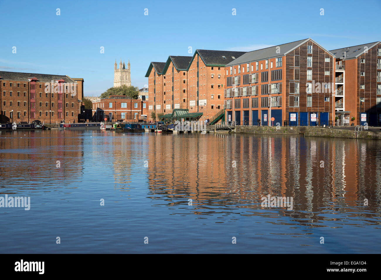 Former warehouses and Gloucester Cathedral, Gloucester Quays, Gloucester, Gloucestershire, England, United Kingdom, - Stock Image