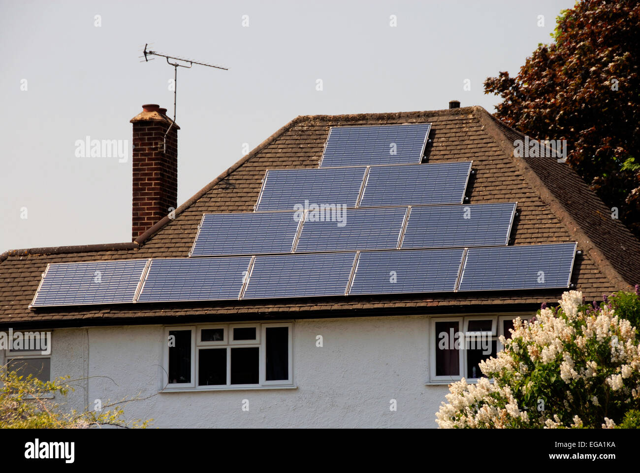 Solar panels on domestic roof - Stock Image