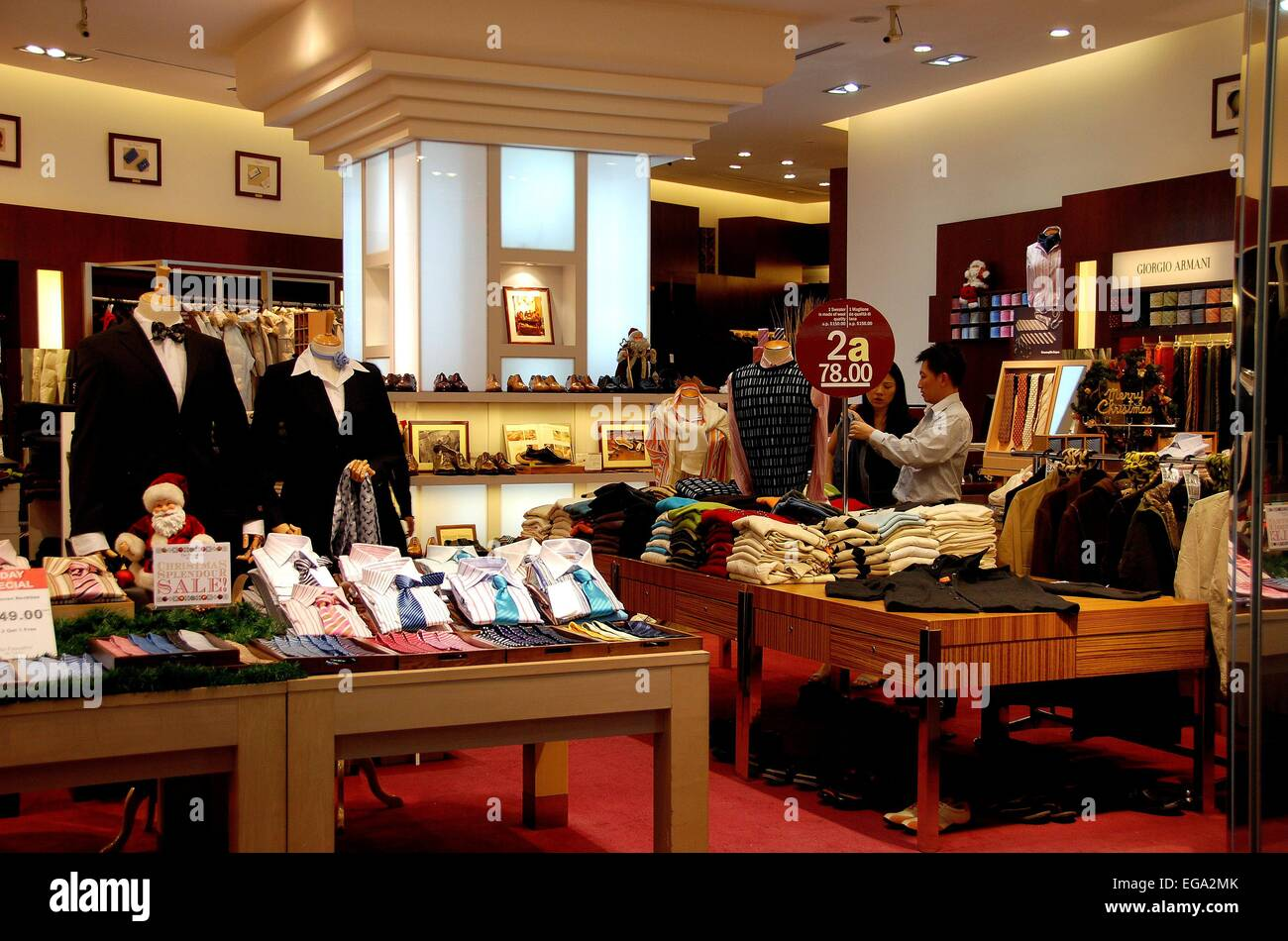 2f9312856e33 Singapore: Sales clerk with customer at an upscale men's clothing shop at  the Raffles City