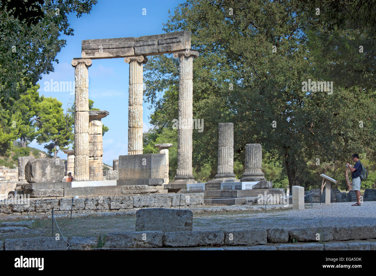 Ruins of the Philippeion, with its three remaining Ionic columns at Ancient Olympia, The Peloponnese Greece - Stock Image