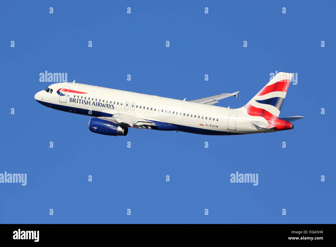 Barcelona, Spain - December 11, 2014: A British Airways Airbus A320 with the registration G-EUYN taking off from - Stock Image
