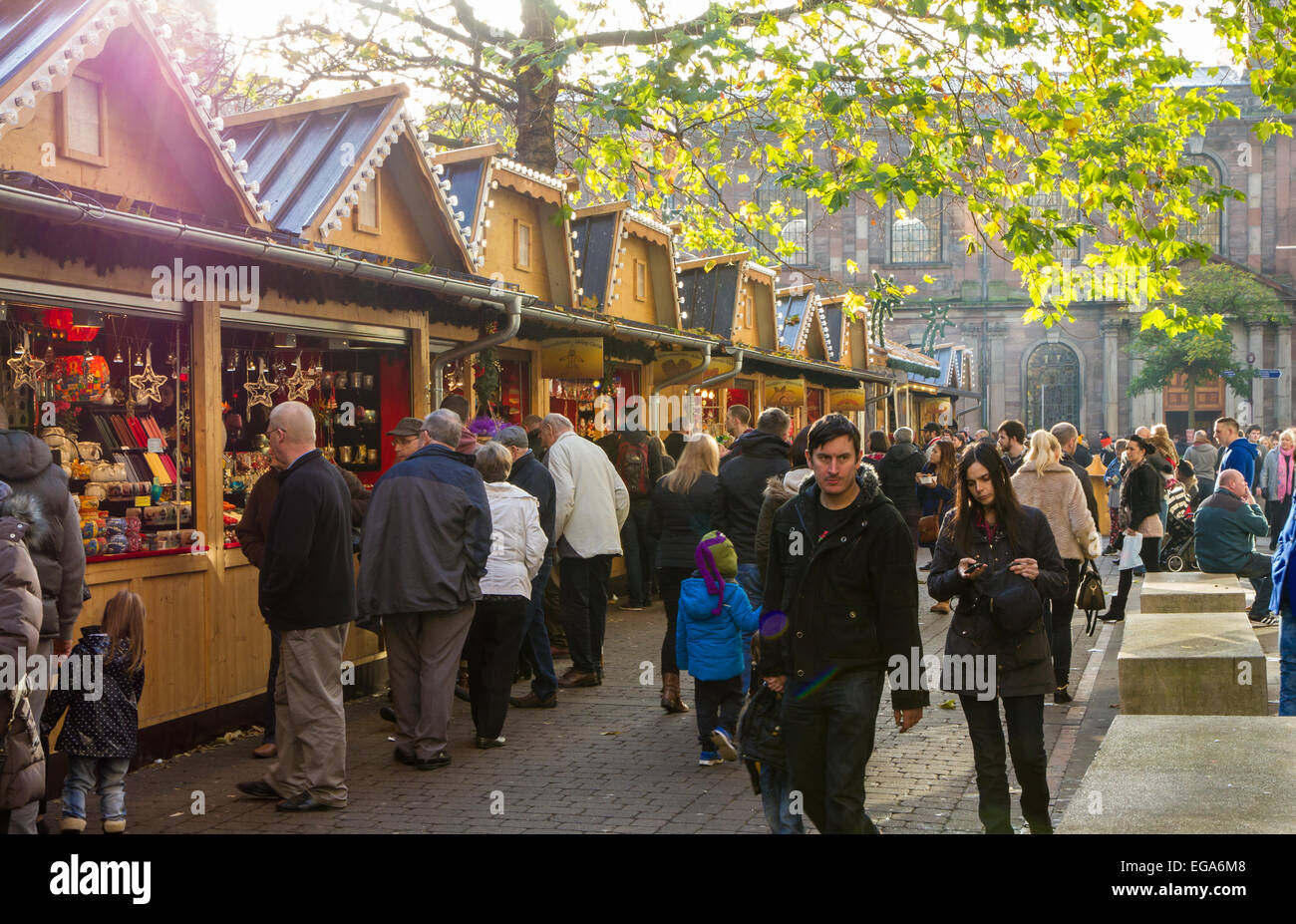 Shoppers at the Christmas Markets in Manchester - Stock Image