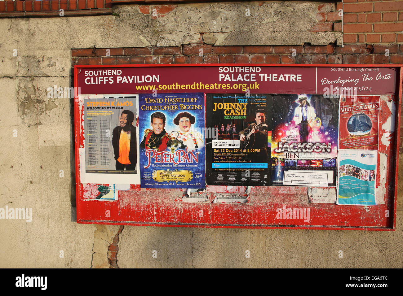 A poster billboard advertising various shows at the Cliffs Pavilion theatre in Westcliff-on-Sea Essex, England. Stock Photo