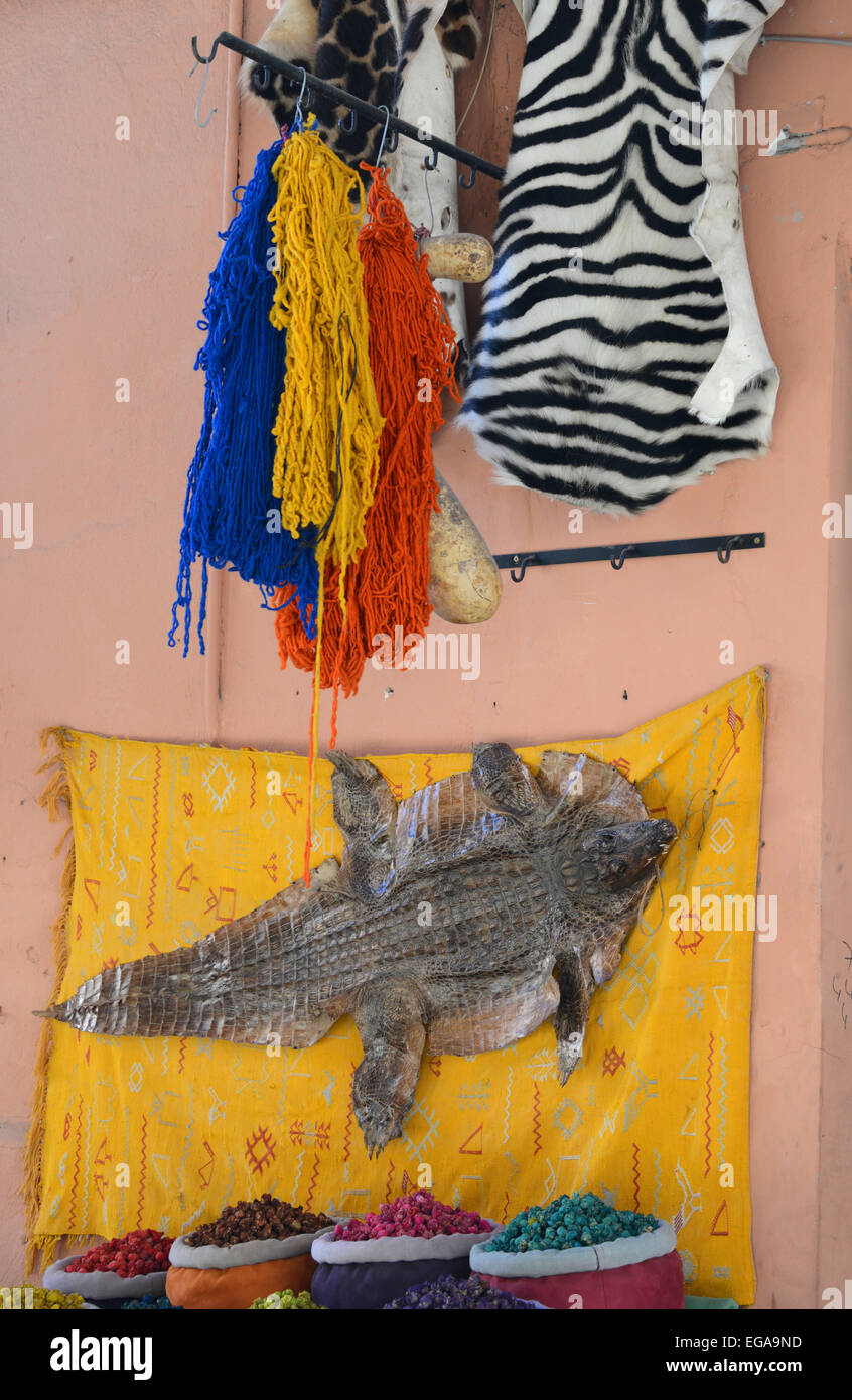 Animal skins, dyed wool, dried flowers display, Marrakech, Morocco - Stock Image