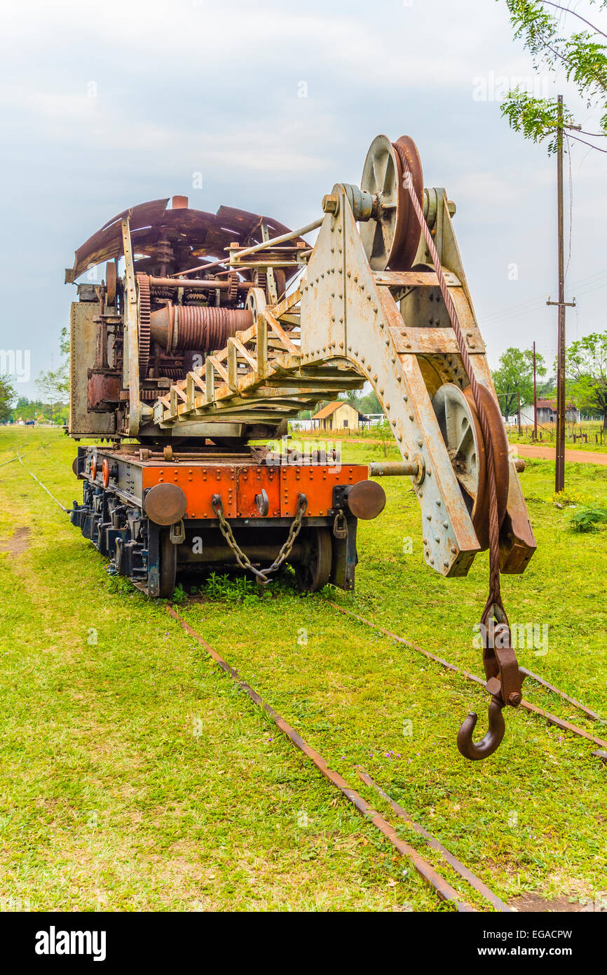 Old 19th century crane railroad car at the railroad museum in Sapucai, Paraguay, South America. - Stock Image