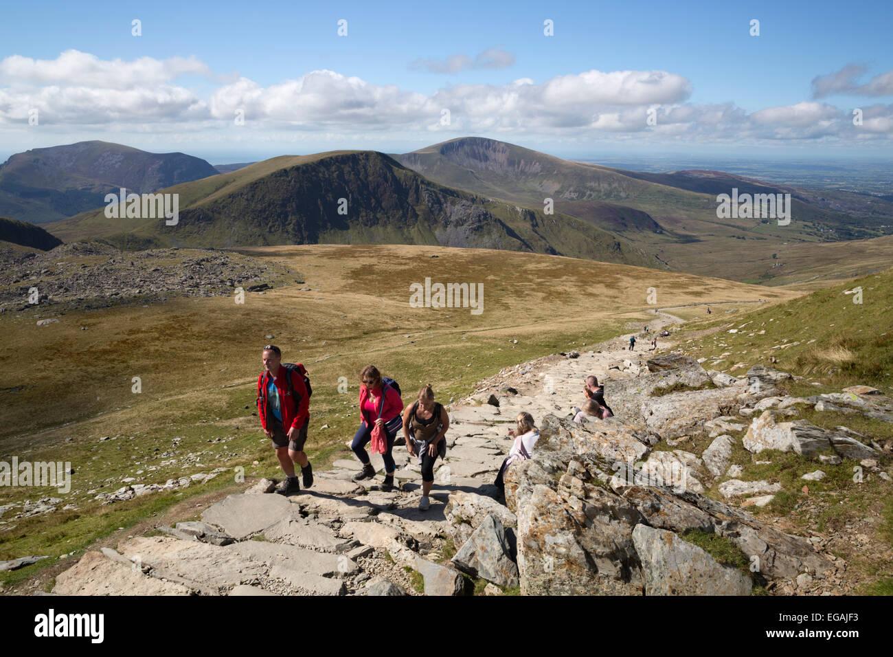 Walkers half way up Snowdon on the Llanberis path, Llanberis, Snowdonia National Park, Gwynedd, Wales; United Kingdom, - Stock Image