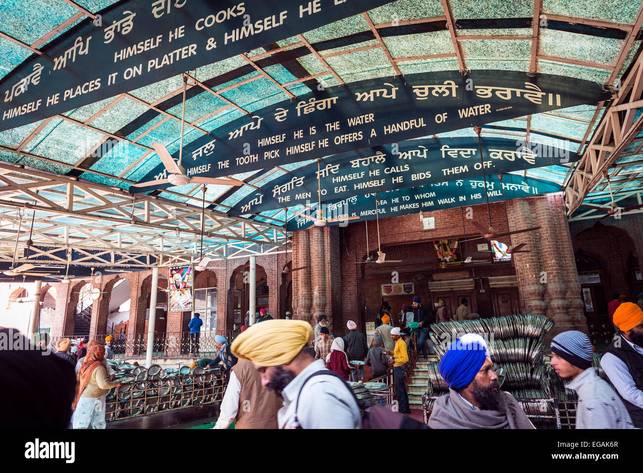 Exit from the communal dining room of The Golden Temple, Amritsar, Punjab, India - Stock Image