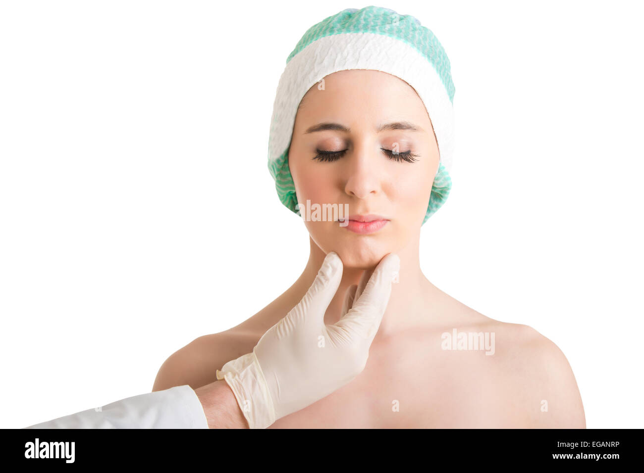 Woman ready for cosmetic surgery in her face, isolated in white - Stock Image