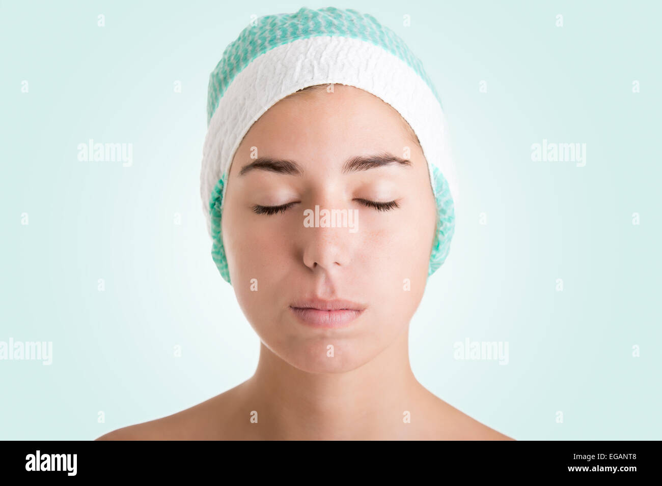 Woman ready for cosmetic surgery with marks drawn on her face isolated in white - Stock Image