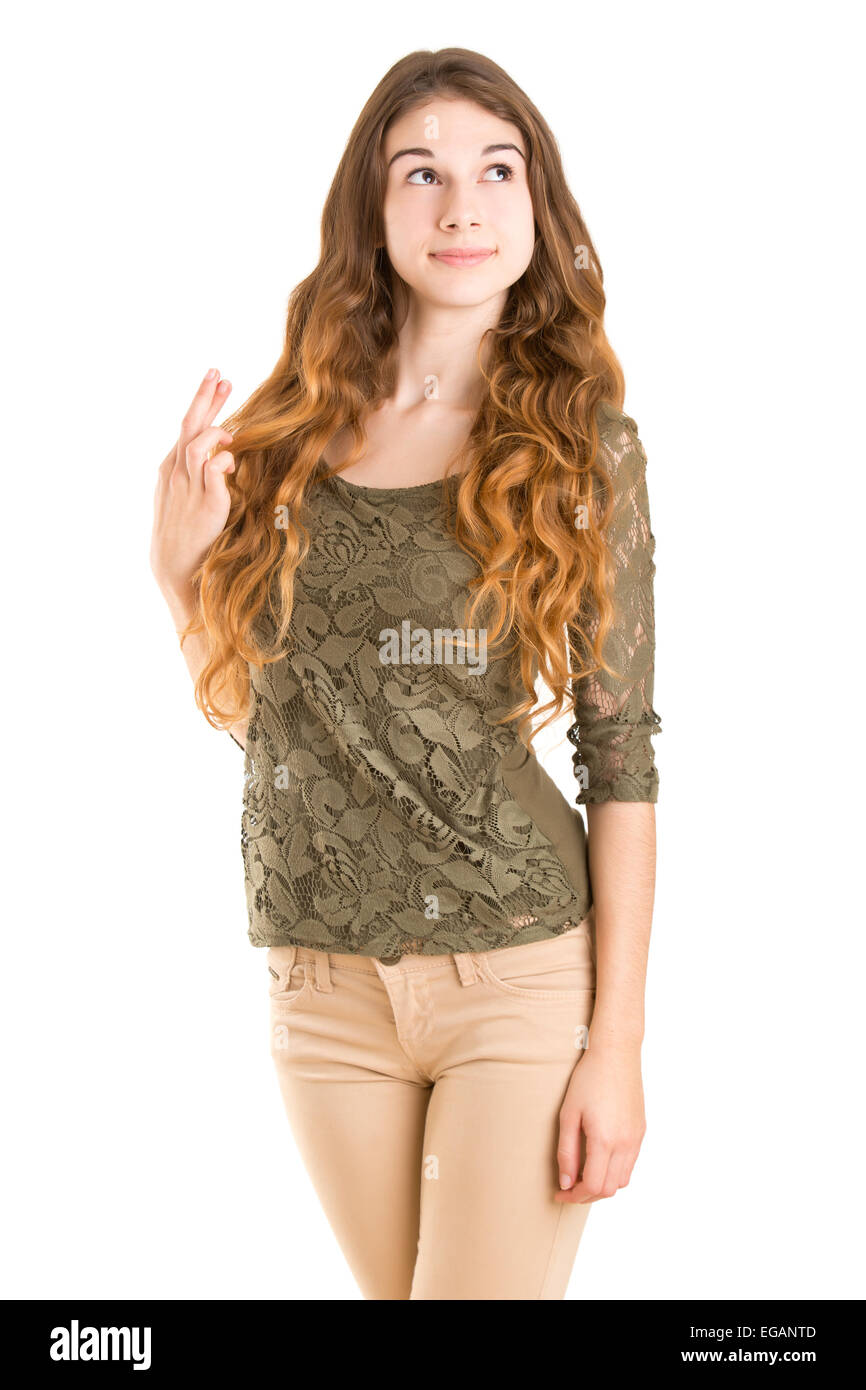 Woman with her fingers crossed for good luck, isolated in white - Stock Image