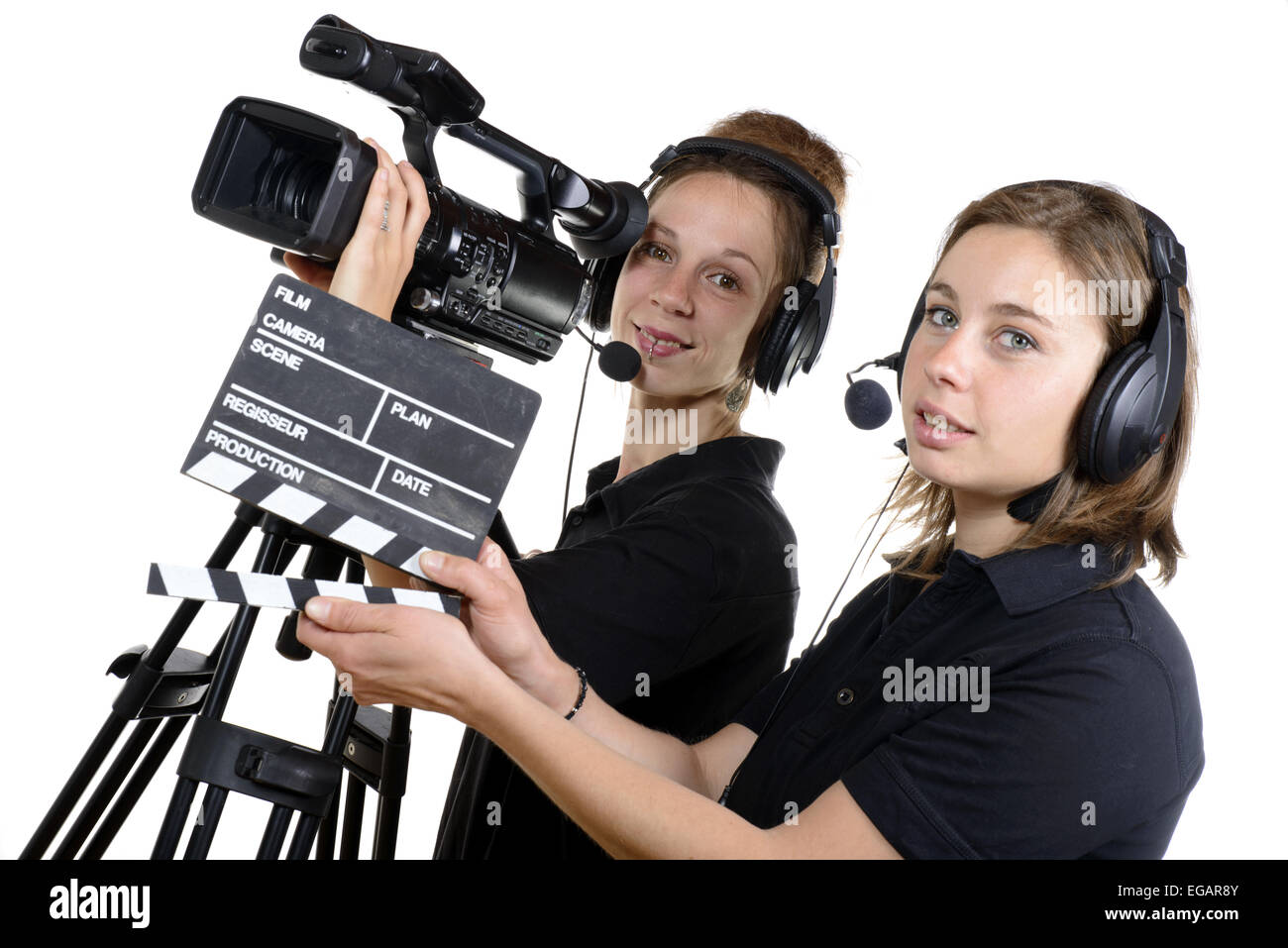 two young women with a video camera and a clapper board Stock Photo ... a75b51b5ad