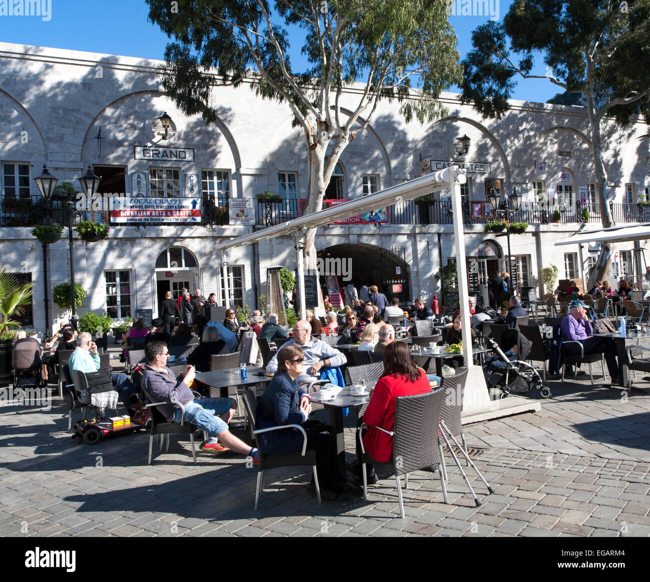 People and cafes in Grand Casemates Square, Gibraltar,  Gibraltar, British territory in southern Europe - Stock Image