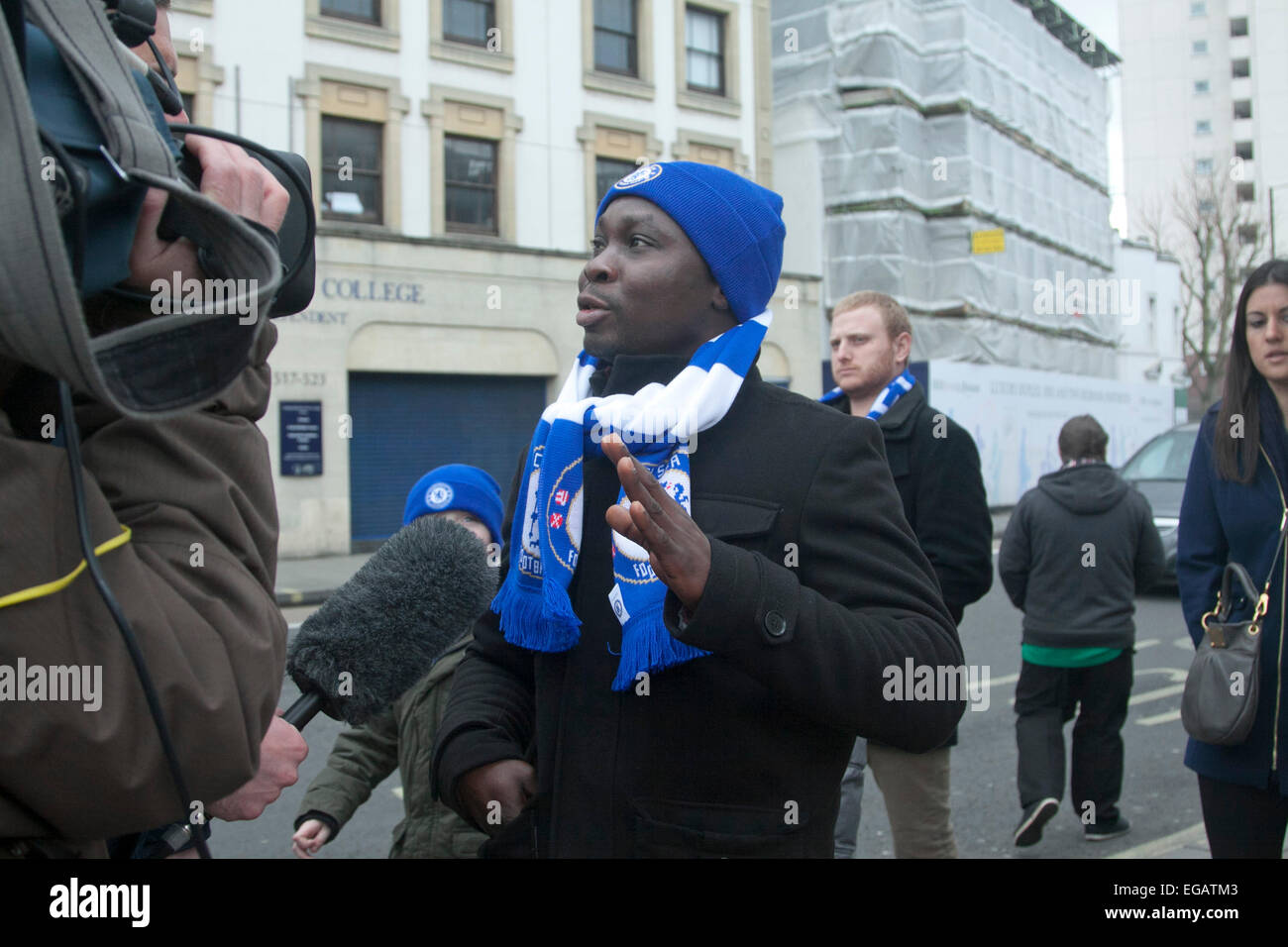 Stamford Bridge London,UK. 21st February 2015. A black Chelsea football supporter arrives for the match against - Stock Image
