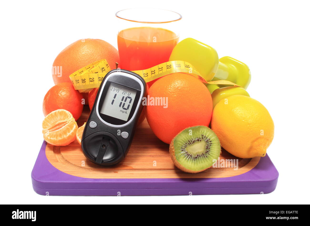 Glucometer. fresh fruits, dumbbells for using in fitness, tape measure and glass of juice, concept for diabetes, - Stock Image