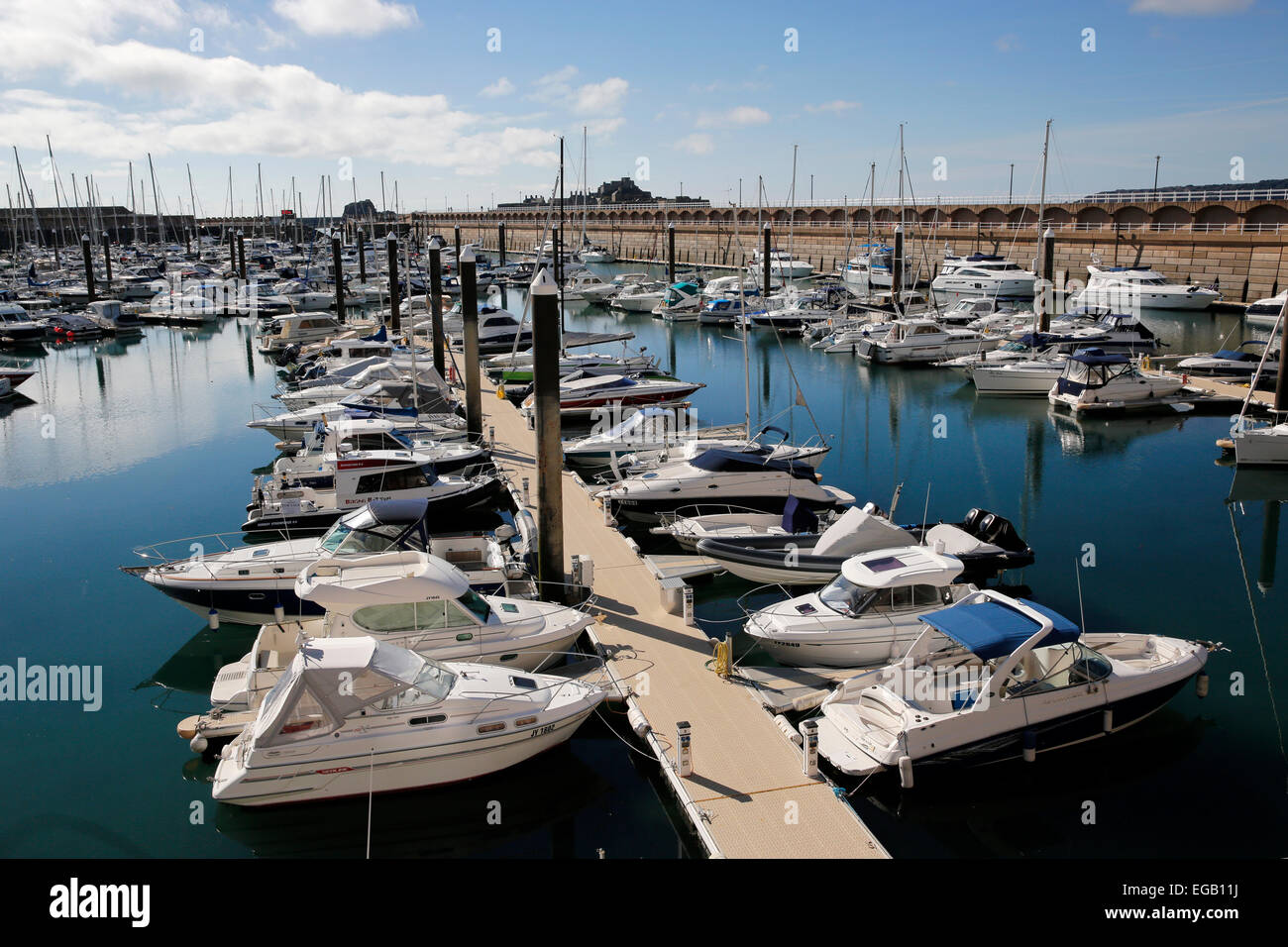 Yachts and motorboats are moored in the marina in St. Helier, Jersey UK - Stock Image