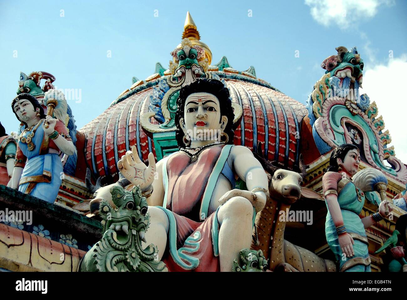 Singapore: Hand-carved colourful Hindu deities on the roof of the Sri Mariamman temple in Chinatown  * - Stock Image