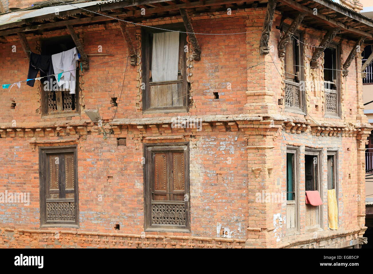 Traditional newar style red brick old house with carved - Brick and wood house ...
