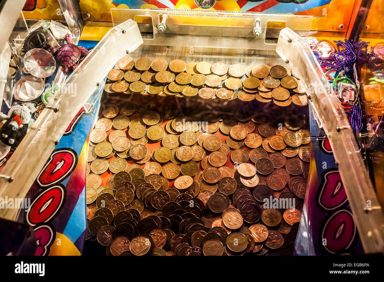 Coin pusher arcade game at Brighton - Stock Image