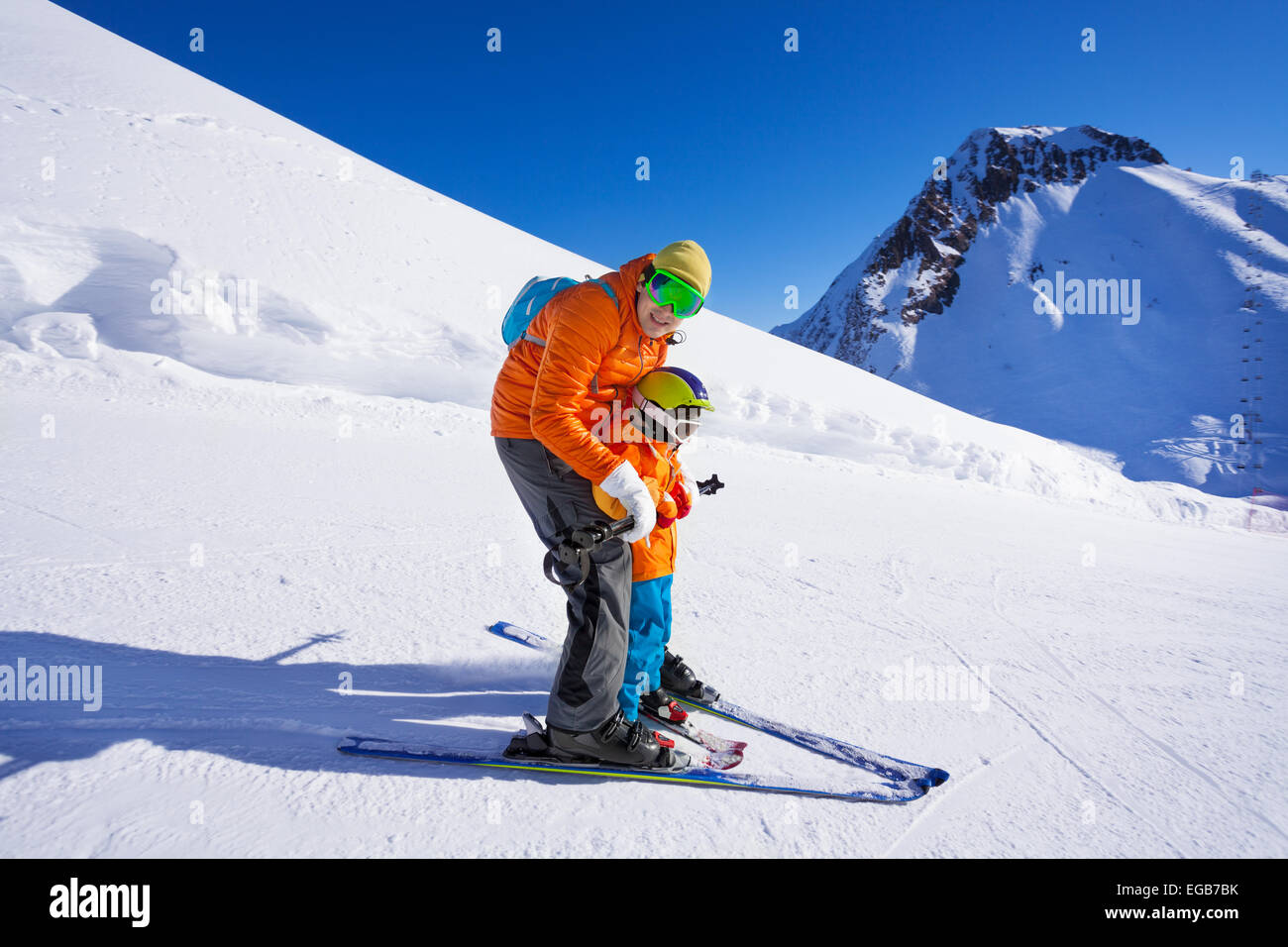 Instructor give ski lesson to little boy - Stock Image