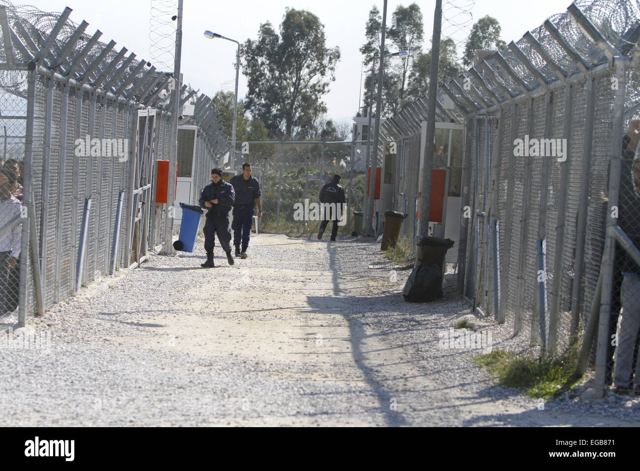 View into the detention camp with two separated areas. Minor scuffles between riot police and protesters broke out - Stock Image