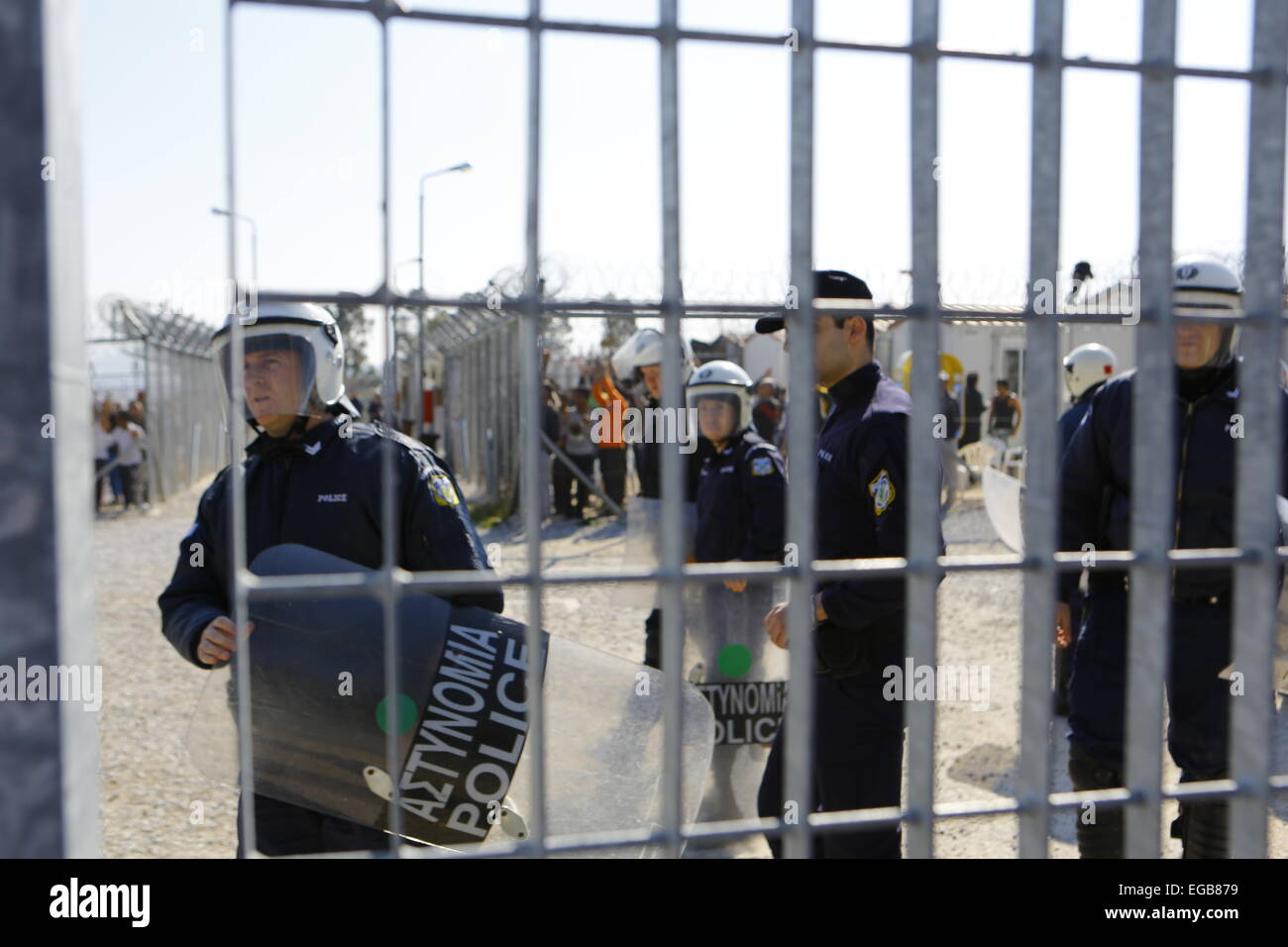 Riot police has moved into the detention camp itself. Minor scuffles between riot police and protesters broke out - Stock Image