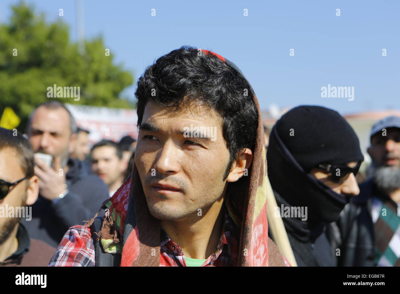 Close-up of one of the protesters. Minor scuffles between riot police and protesters broke out at the Amygdaleza - Stock Image