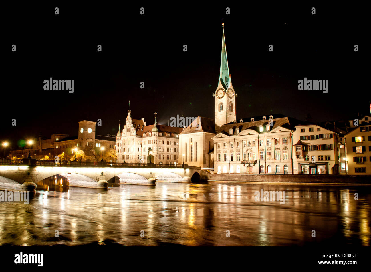 Night time in downtown Zurich, Switzerland. View of the Fraumunster church over the Limmat River. - Stock Image