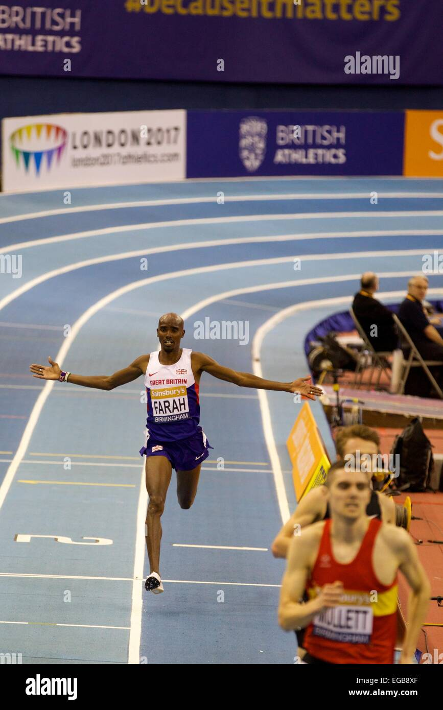 Birmingham, UK. 21st Feb, 2015. Mo Farah crosses the finish line of the Men's 2 miles event at the Barclaycard - Stock Image