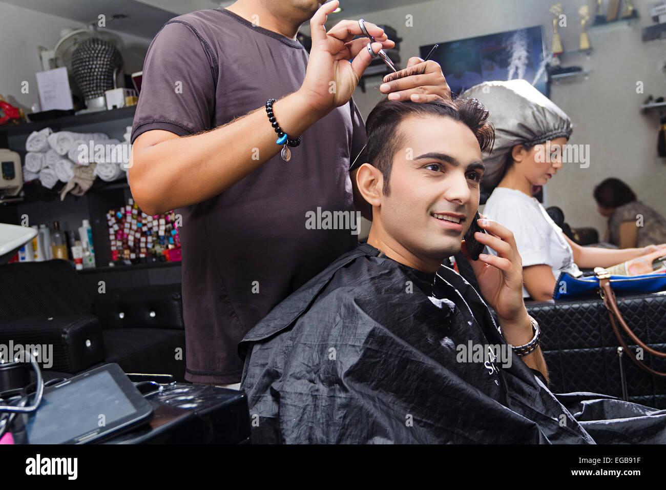 12 indian people Hairdresser Cutting Saloon talking phone Stock