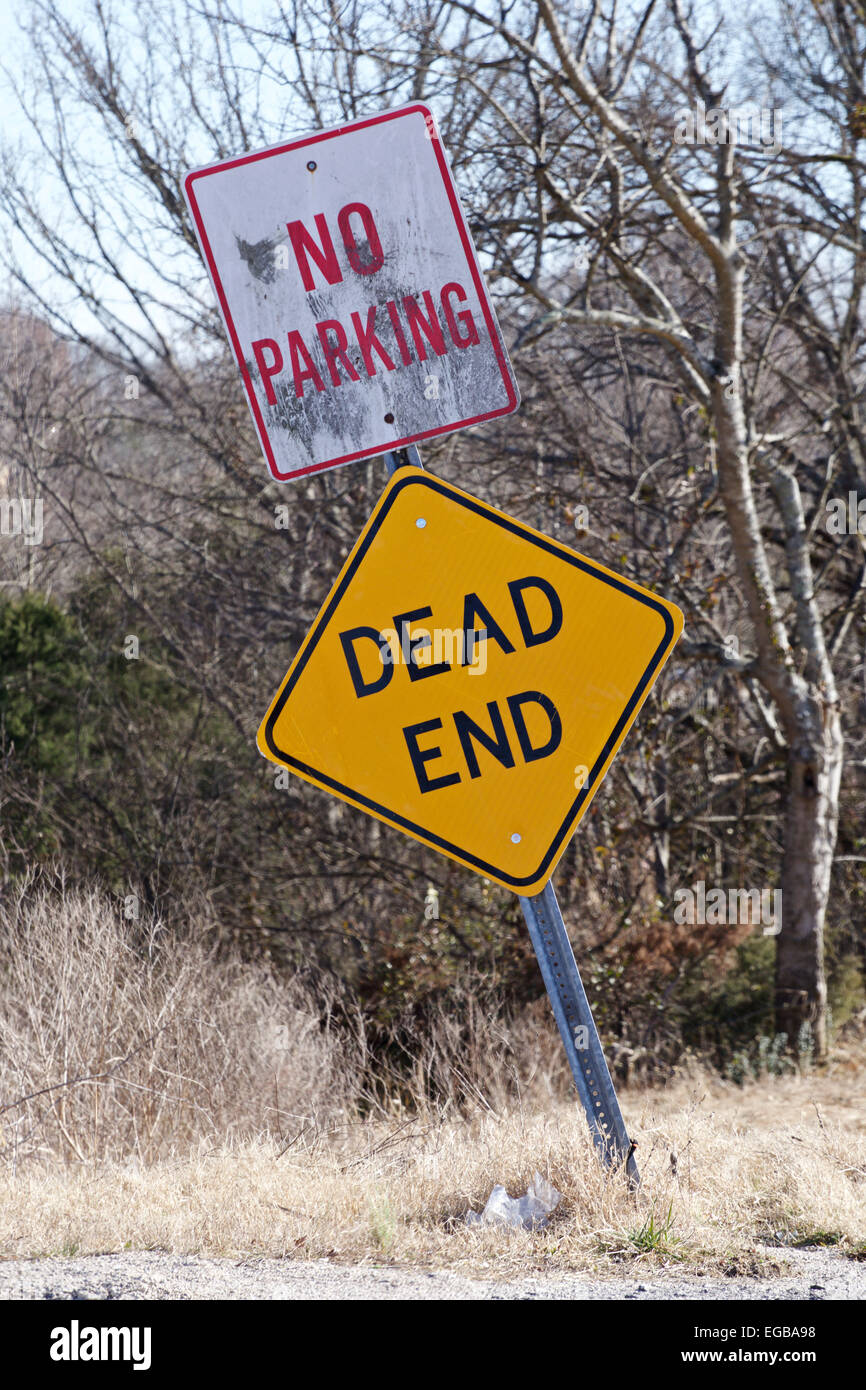 Dead end and No Parking sign post at the end of a rural road. - Stock Image