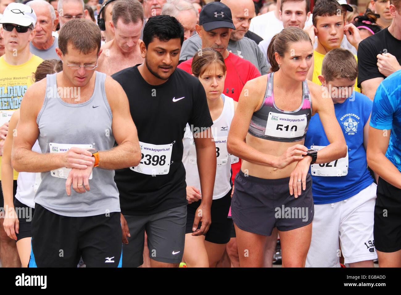 Runners preparing for a 5K run or walk sports event. Beavercreek Popcorn Festival, Beavercreek, Dayton, Ohio, USA. - Stock Image