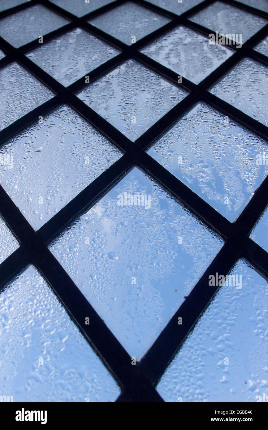 Condensation on old leaded glass windows - Stock Image