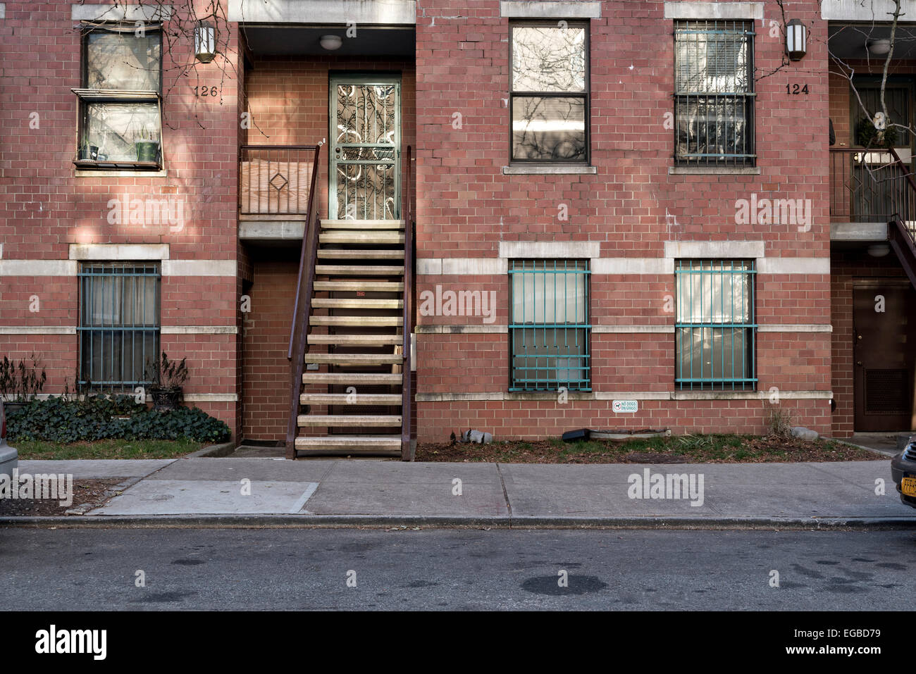 Multi-Family home in a modest section of Williamsburg, Brooklyn, NY, secority bars on the windows. - Stock Image