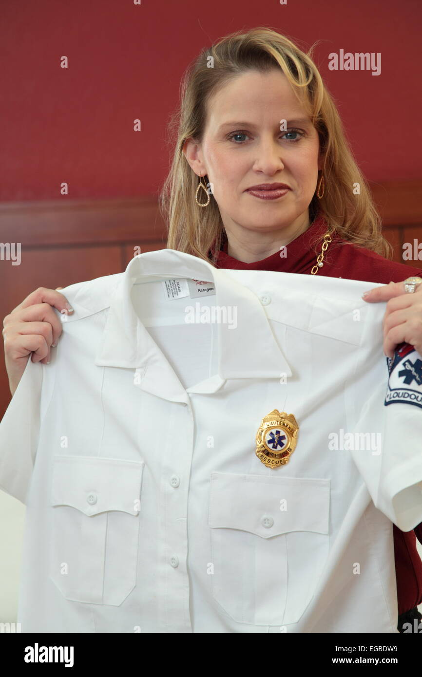 EMT and her uniform - Stock Image
