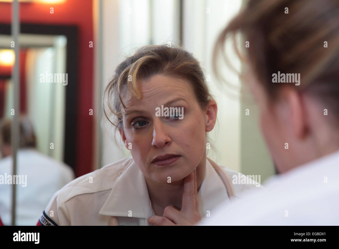 EMT takes her own pulse - Stock Image