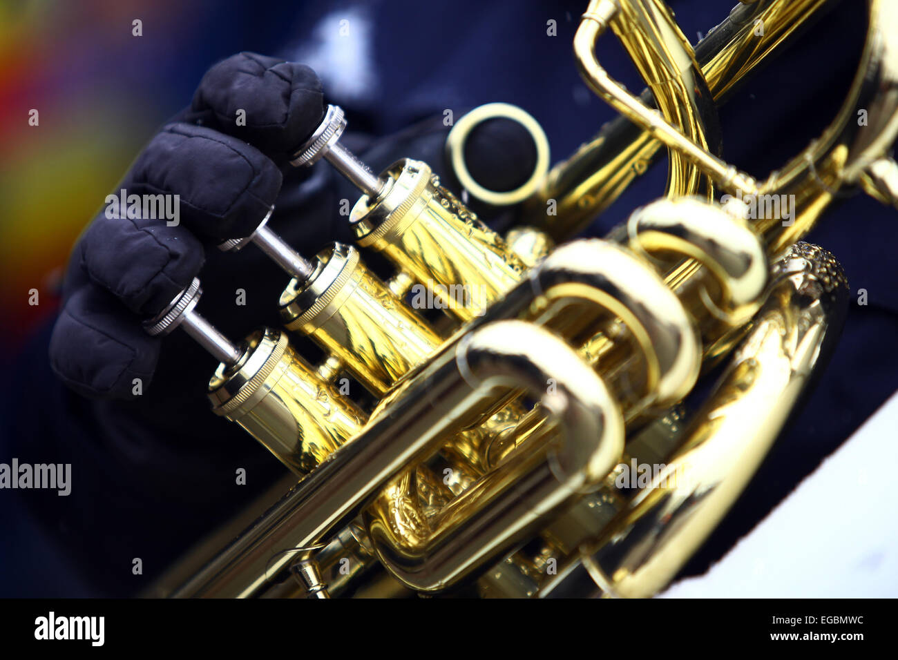 Color image of a horn being played on a snowy day. - Stock Image