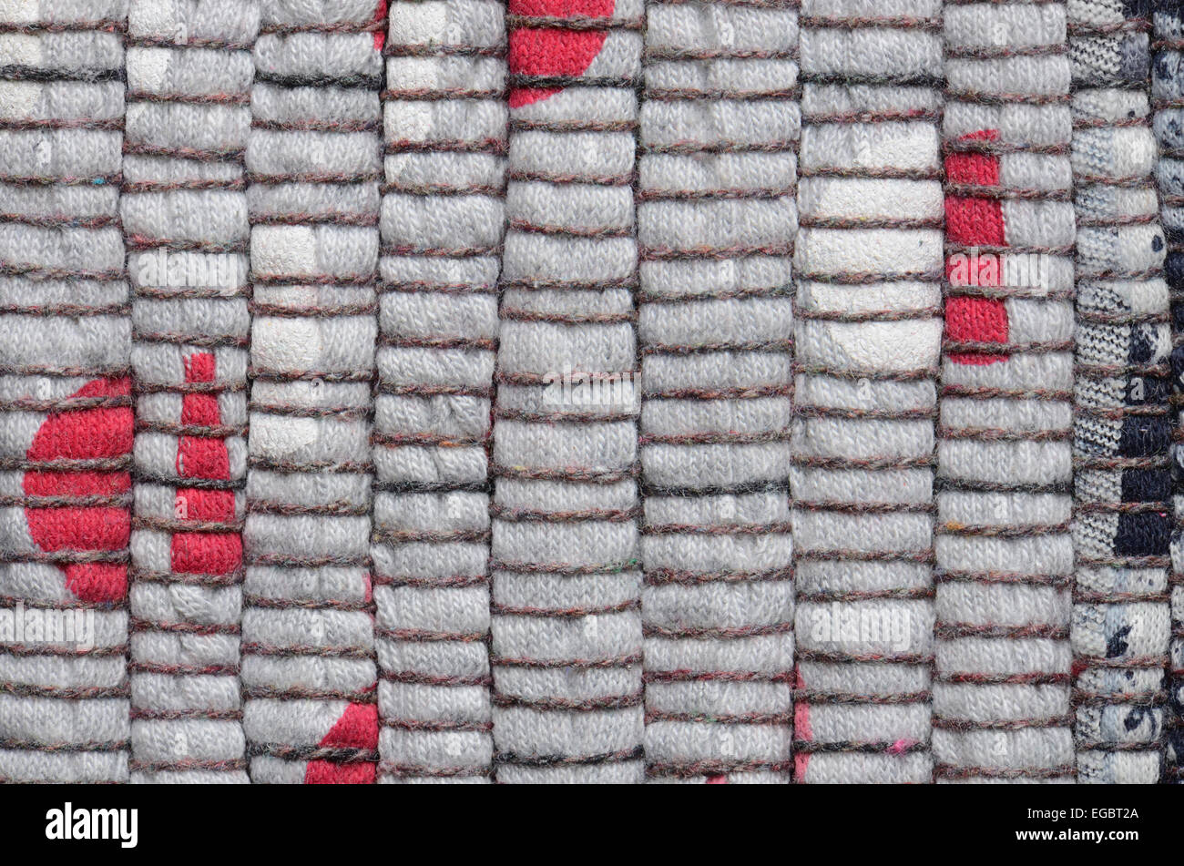 close up varicolored knitted carpet background - Stock Image