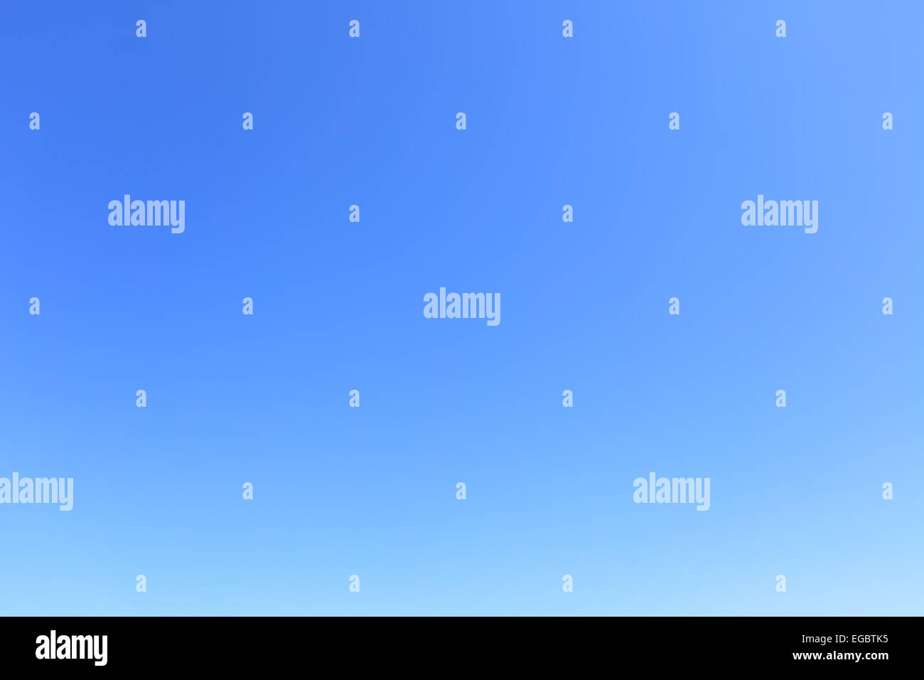 Clear cloudless blue sky, may be used as background - Stock Image