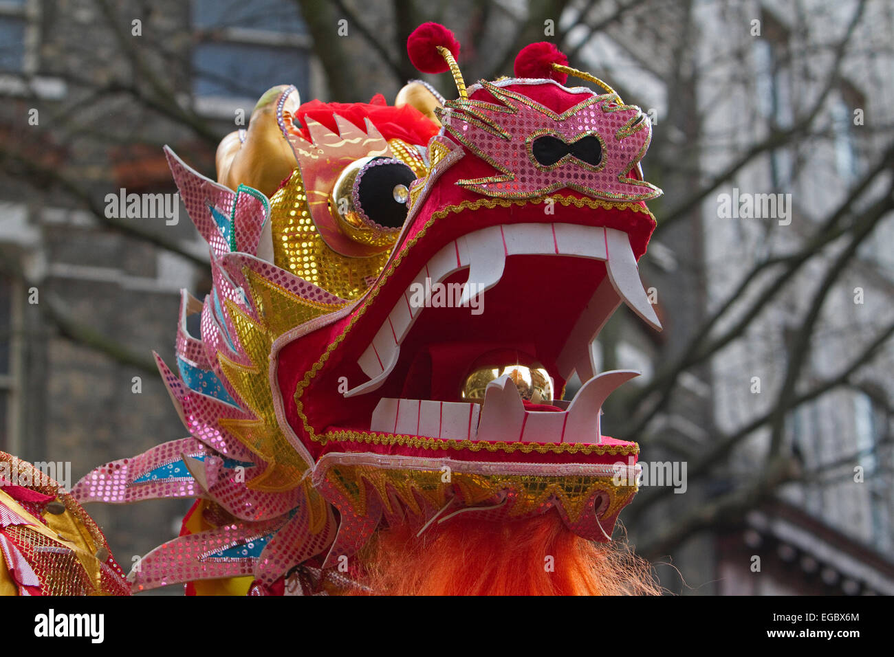 chinese dragon head at the chinese new year parade in london stock