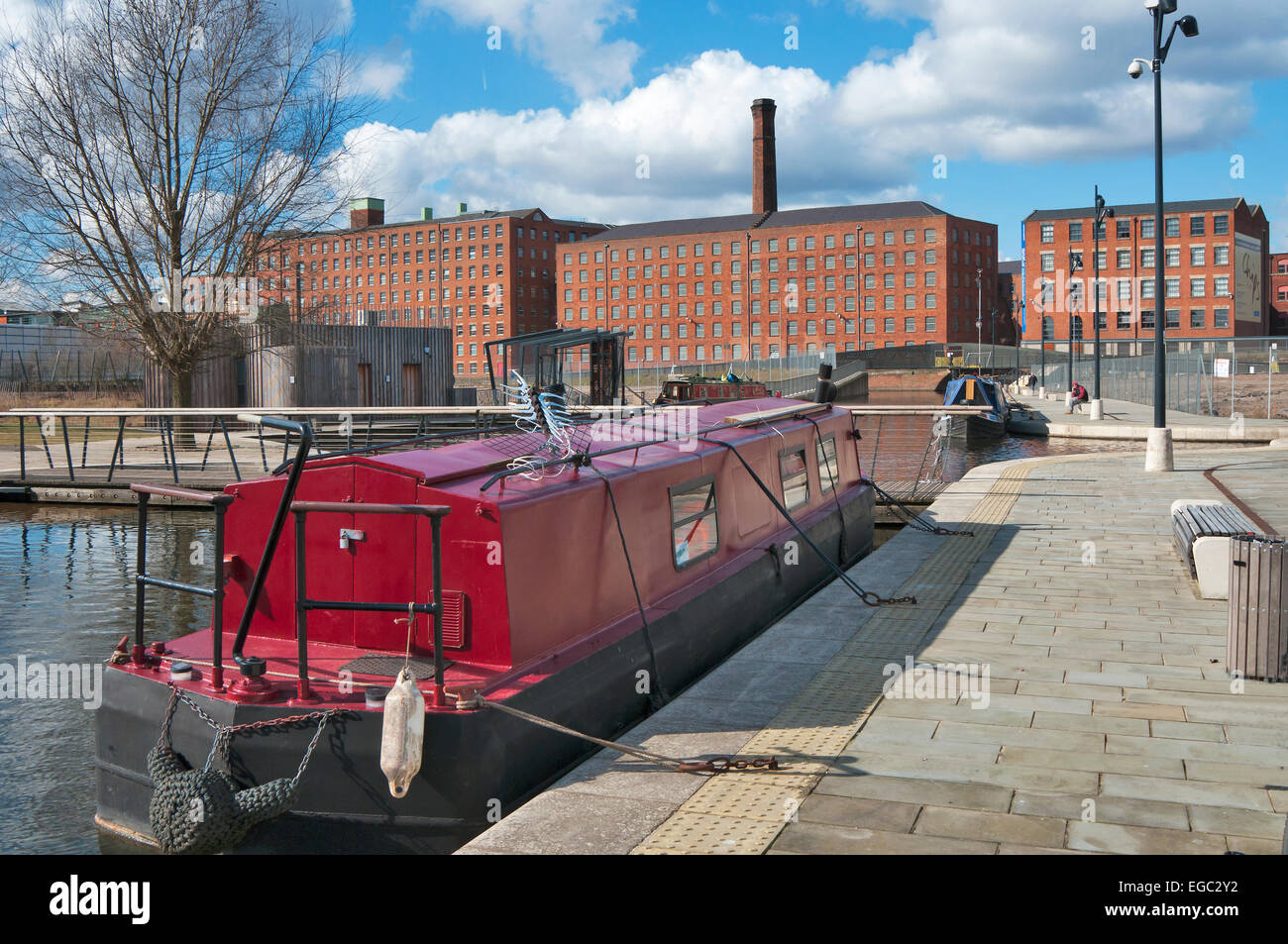 Canal barge in New Islington central Manchester,Ancoats Murray's Mills on the Rochdale canal in the background. - Stock Image
