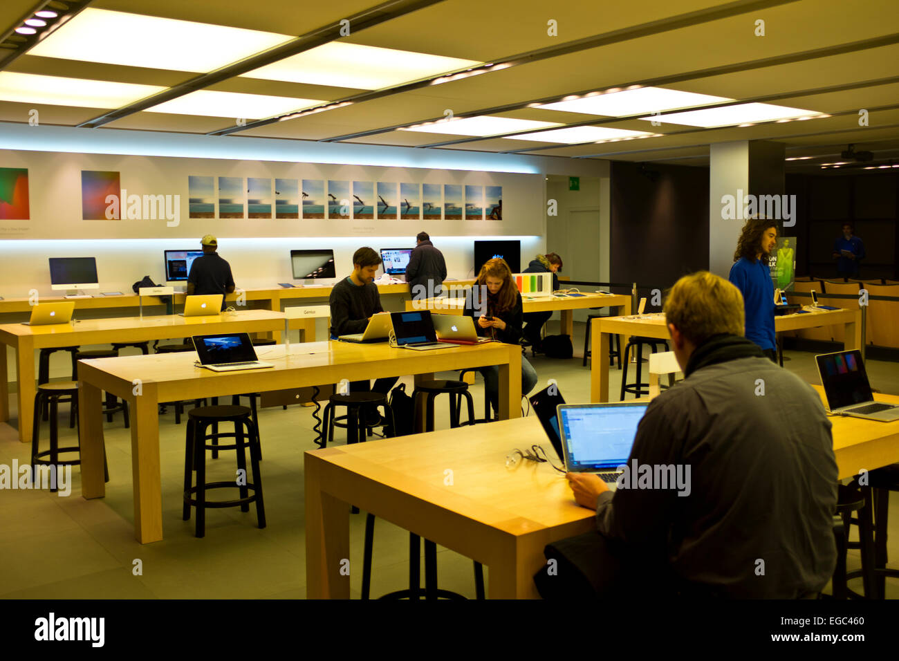 Apple store,Very Busy store where large numbers of Apple Products are sold,Iphone 6 plus,Ipad Air 2,235 Regent Street,London Stock Photo